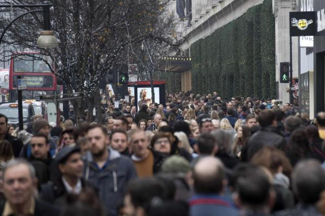 Shoppers flocked to Oxford Street today to squeeze in some late Christmas shopping