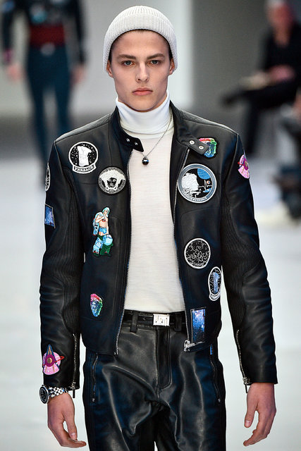 Versace's fall men's wear collection included a patch-covered jumpsuit. Credit Firstview