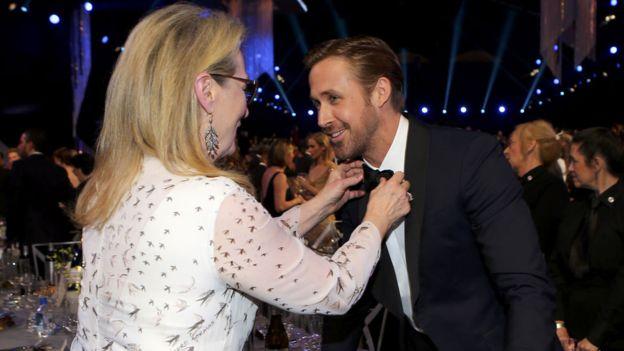 Meryl Streep adjusts Ryan Gosling's tie at the Screen Actors Guild awards