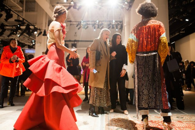 The designer Rosie Assoulin gave Ms. Brown a tour of her presentation on Monday. Credit Danny Ghitis for The New York Times